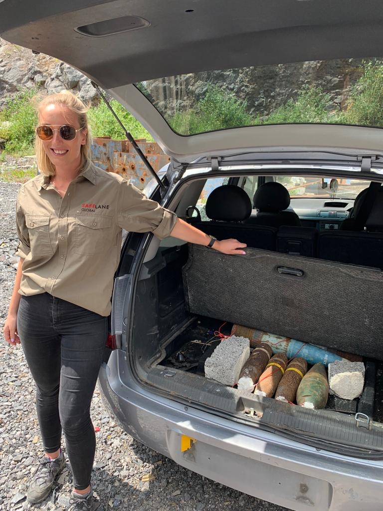 Project Executive Bryony Broadman with a car boot full of explosive ordnance