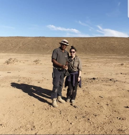 Project Executive Melanie Villegas in the desert while on an international project visit