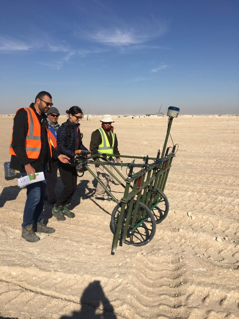 Alice Taylor trying out a non intrusive survey in the desert during a project visit to Kuwait.