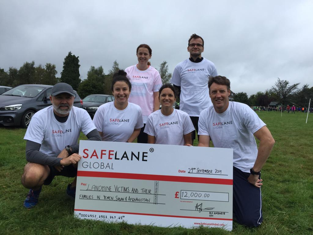 Adam with SafeLane staff raising money for charity